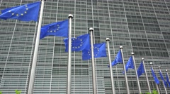 European Union flags in front of European Commission in Brussels - stock footage