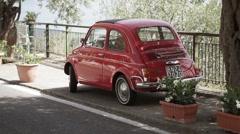 Red old car in Italian coast Stock Footage