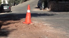 Safety cone on the dug up road 2 Stock Footage