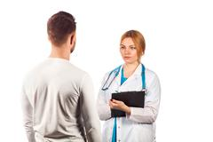 Female doctor holding application form while consulting patient - stock photo