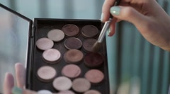 Makeup brush taking cosmetics from palette Stock Footage