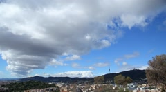 Cumulus clouds skirr past over Barcelona and Serra de Collserola, Mount Tibidabo Stock Footage