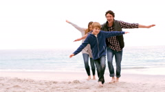 Family running with arms outstretched Stock Footage