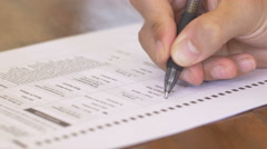 4k Shot of a hand filling out a voting ballot Stock Footage