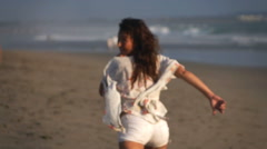 Scared woman running on beach, super slow motion 240fps Stock Footage