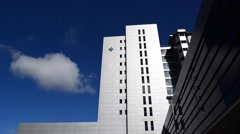 Generic Health care Hospital exterior with blue sky and clouds Stock Footage