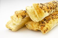 Puff pastry, with caraway seeds Stock Photos