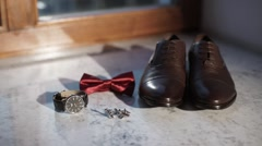 Man's accessories: shoes, bowtie, watch, cuff links - stock footage