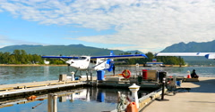 4K Sea Planes, Propeller Start, Dock with North Vancouver in Background, Canada Stock Footage