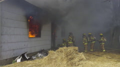 Firefighters deal with a lot of smoke Stock Footage