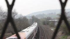 Train Travelling Along Tracks Focus Pull From Bridge Stock Footage