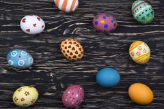 Painted Easter eggs on wooden background. - stock photo
