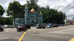 Crossroad with traffic and the Masjid Malabar Mosque Stock Footage