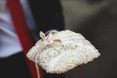 Luxurious rings in the church. Wedding ceremony - stock photo