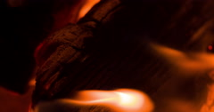 Log being burnt by hot flame 4k - stock footage