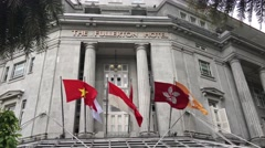 Flags at the fullerton hotel Stock Footage