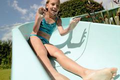 Girl enjoying waterslide Stock Photos