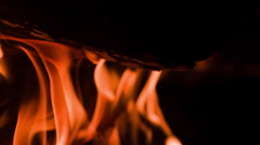 Flames burning fire wood at night slow motion - stock footage