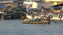 Floating fruit and vegetable market, traditional row boat in Mekong, Vietnam - stock footage