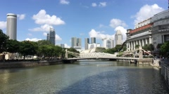 Singapore river with the Cavenagh Bridge Stock Footage