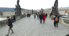 Walking with tourists over Charles,Karlov Bridge,Prague,Praha,Czech Republic 3 Stock Footage