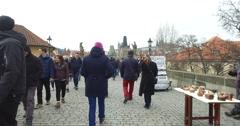 Walking with tourists over Charles,Karlov Bridge,Prague,Praha,Czech Republic 4k Stock Footage