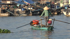 Traditional floating fruit vegetable market, rowing boat, woman, Vietnam, Asia Stock Footage