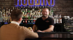 The bartender serves the client Stock Footage