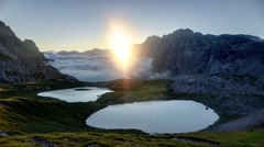 Sea of clouds at sunrise, with lake - 4K time lapse - stock footage