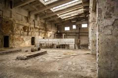 Abandoned industrial interior - stock photo