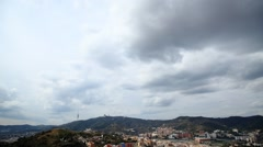 Cumulus clouds gather to gray rainy cloudscape over Barcelona, then cleared away Stock Footage