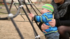 Happy child playing with his mother on the playground Stock Footage