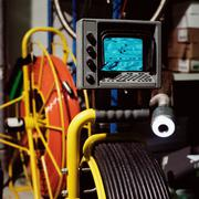Coiled pipe and monitor Stock Photos