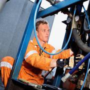 Engineer working on machinery - stock photo