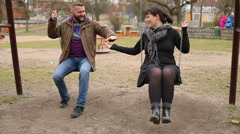 Couple swings at the swings on the playground  - stock footage