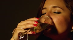 Hispanic model sipping from champagne glass, with eyes closed - stock footage