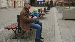 Dad chatting and spend time with child in the city center  - stock footage
