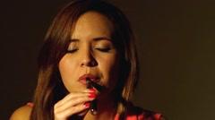 Hispanic model headshot using e-cigarette Stock Footage