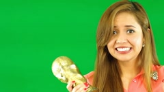 Stock Video Footage of Model in front of green screen holding trophy cheering