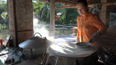 Rice noodles pancakes workshop, small local factory in Vietnam, Asia - stock footage