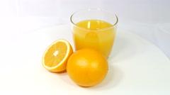 Oranges and orange juice isolated on white background Stock Footage