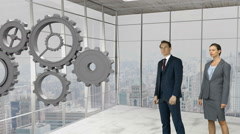 Business people standing in front of gear-wheels Stock Footage