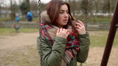 Young woman breathes hersefl on hands and swing Stock Footage