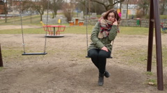 Tired woman swinging on swing  Stock Footage