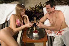 Couple toasting on honeymoon Stock Photos