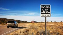 Buckle Up It's The Law Road Sign on Arizona Highway Stock Photos