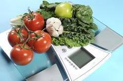Healthy diet and weight loss concept with healthy vegetables including tomato Stock Photos