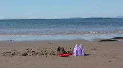 Sunny Beach In North Wales With A Bucket and Spade - stock footage