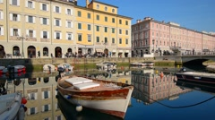 Trieste, Italy. Old boat on the canal in the Italian city of Trieste. Stock Footage