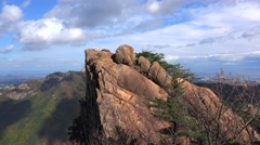 Rock formations & downtown Sokcho with the East Sea from the Mt. Seorak, Stock Footage